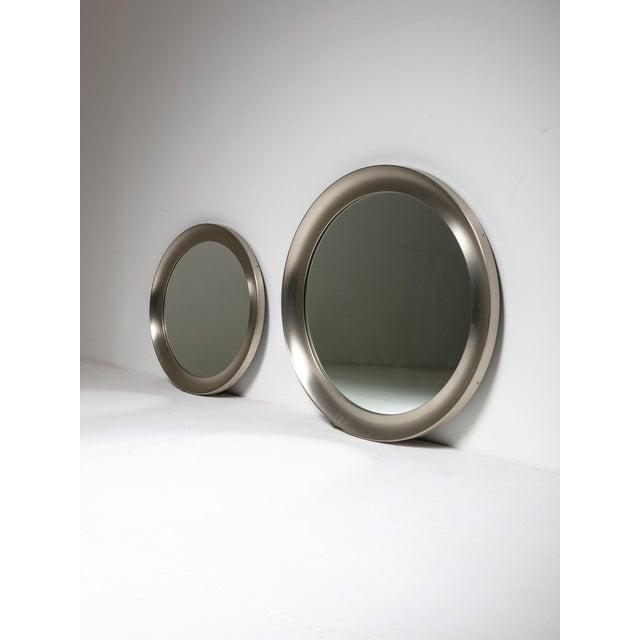 Two Narcisso mirros by Sergio Mazza for Artemide. Nickelled opaque brass frames - diameters cms 62 and 83 Also available a...