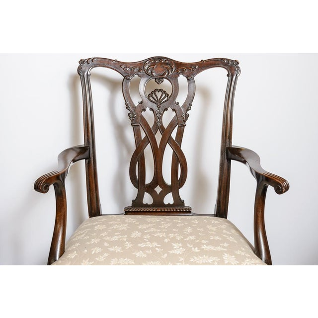 Beautiful set of Chippendale Style dining chairs. Two arm, six side with finely carved splats and backs and having fluted...