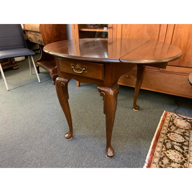 Design Plus Gallery presents a Queen Anne Style Dropleaf + Drawer Side Table. Rich mahogany stain complements the...