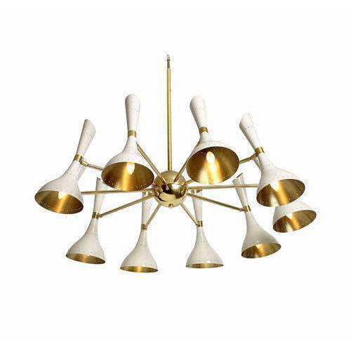 The Durrell Chandelier by Studio Van den Akker is constructed of brass and is available in multiple head configurations...