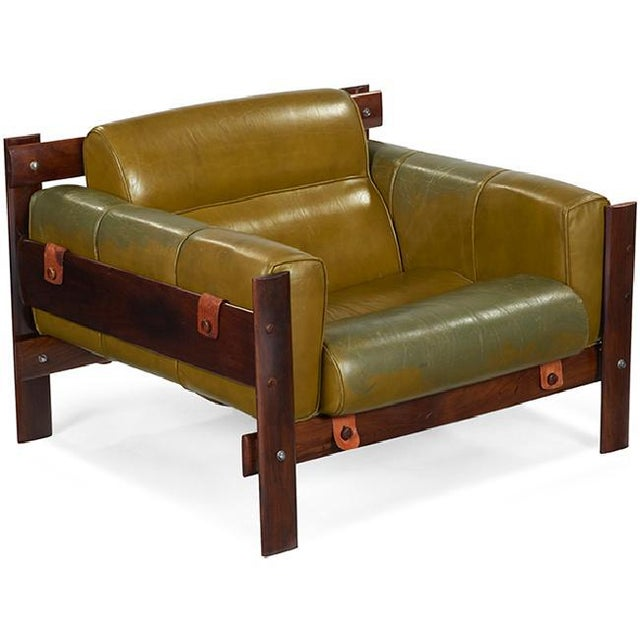 This beautiful and rare chair is by famed Brazilian designer Percival Lafer. The rosewood frame is accented by leather...