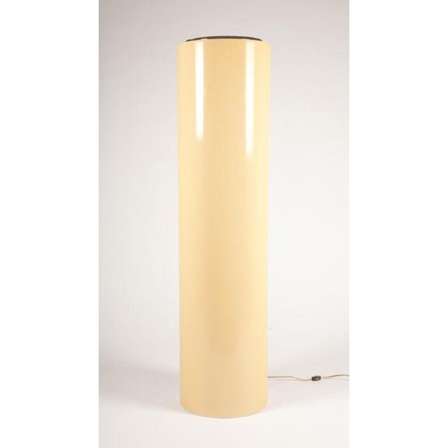 A mod pair of pedestal lights. This unique pair consists of tall cylindrical forms of fiberglass in pale yellow with a...