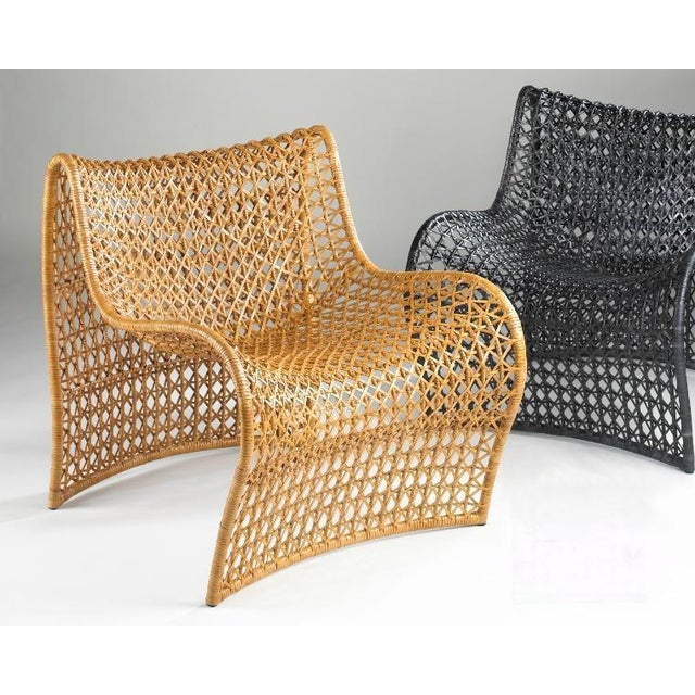 An open weave of leather covers a sensual shape, making the Lola chair a perfect design for style and comfort.