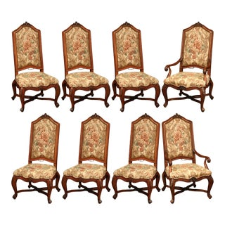 Important Set of Eight French Carved Walnut Dining Chairs and Armchairs