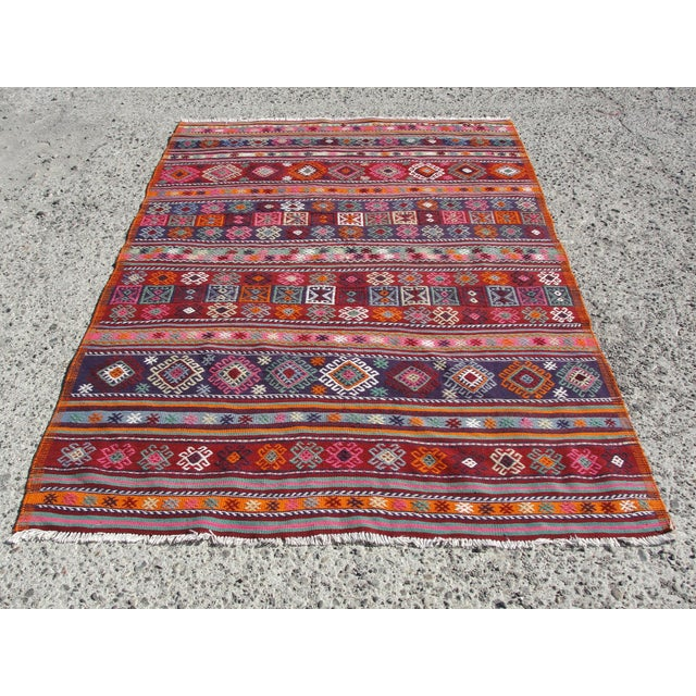 Vintage handwoven Turkish kilim rug. The kilim is nearly 40 years old. It is handmade of very fine quality natural wool in...