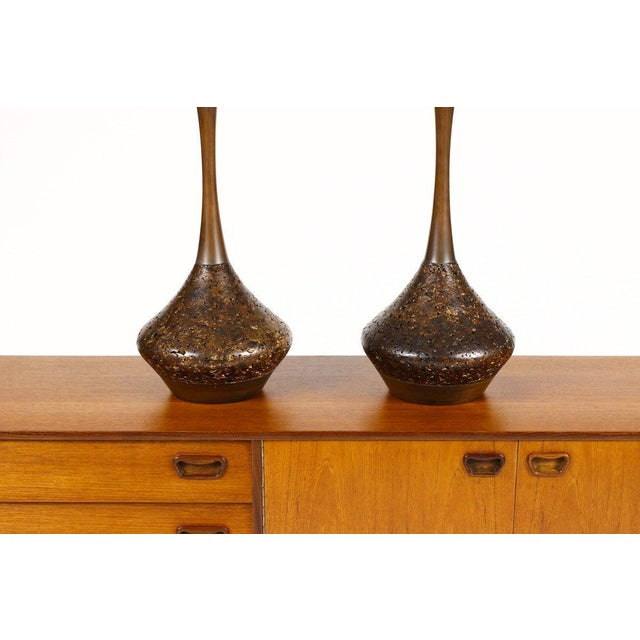 Nice vintage table lamps. Cork bodies with slender tapered turned walnut necks. Good shape overall. Each lamp measures:...