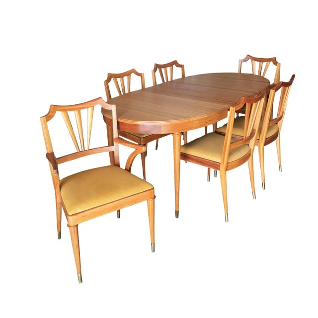 Reminiscent of Adrian Pearsall designs, this formal midcentury dining room set includes a dining table, two leafs, petite...