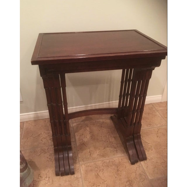 George III style mahogany quarte of table in bamboo imitation support legs. Each table fits inside another.