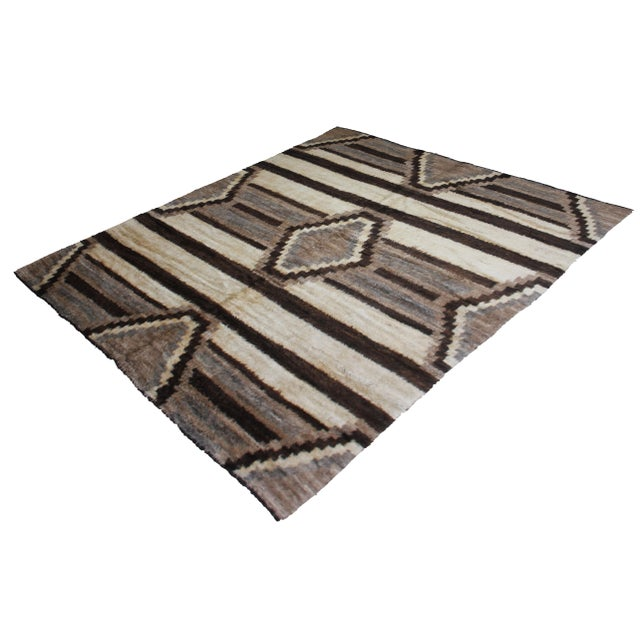 A beautiful handmade Navajo rug. It's geometric design woven in by Aara Rug hands. This rug is made of 75% bamboo silk and...