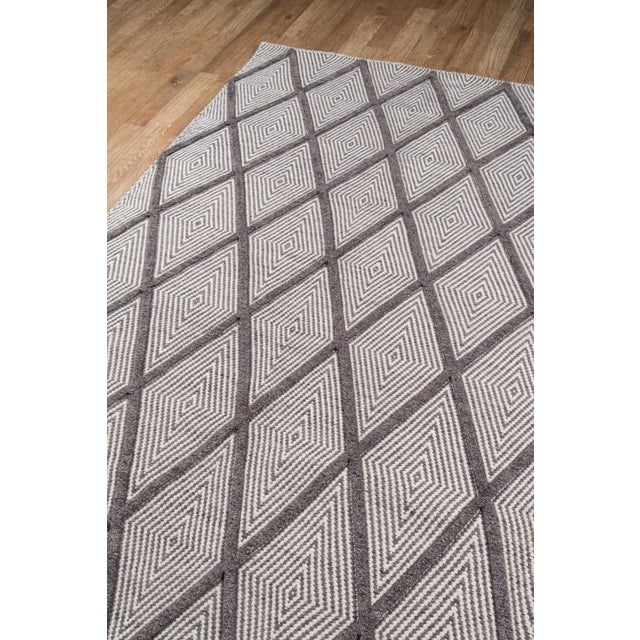 Instill interior floors with a sense of comfortable calm in this decorative area rug collection that conveys a hip hygge...