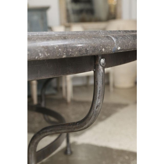 Belgian bluestone table on steel base. Round thick bluestone table top from Belgium upon a four-legged steel base. Top is...