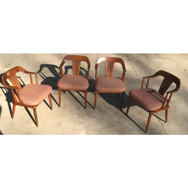 Beautiful set of four Tomlinson Mid Century dining chairs with cane panel backs. I believe these are bleached walnut and...