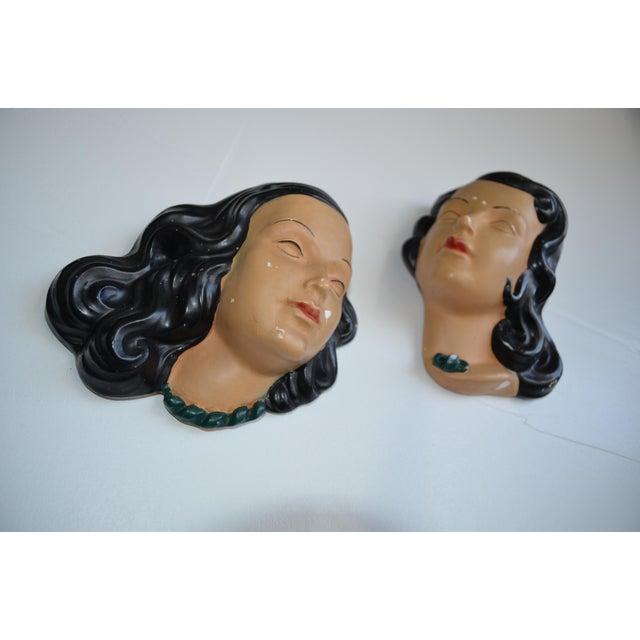 Pair of mid century terra cotta women's faces wall masks/art. In the style of Goldscheider/Prischi. Art Deco vanity masks.