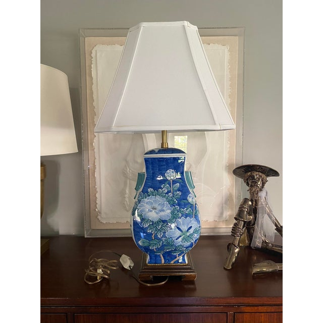 Asian lamp in the most serene, comforting blues. Wood base, excellent condition. Age is an approximation. Lamp shade is...