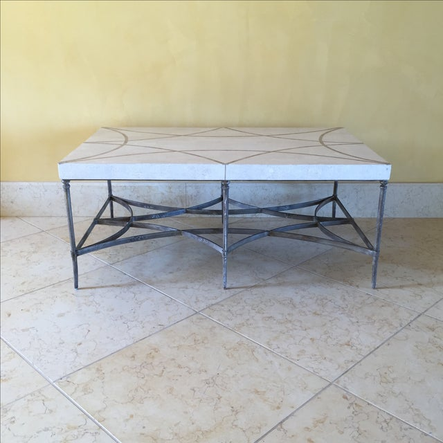 Elegant coffee or cocktail table with patterned fiberglass top and metal base. Faux stone has the look of marble with...