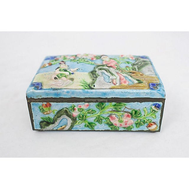 """Late 19th century Chinese enamelware box with hand-painted raised motif. Cedar lined interior. Embossed """"China"""". Minimal..."""