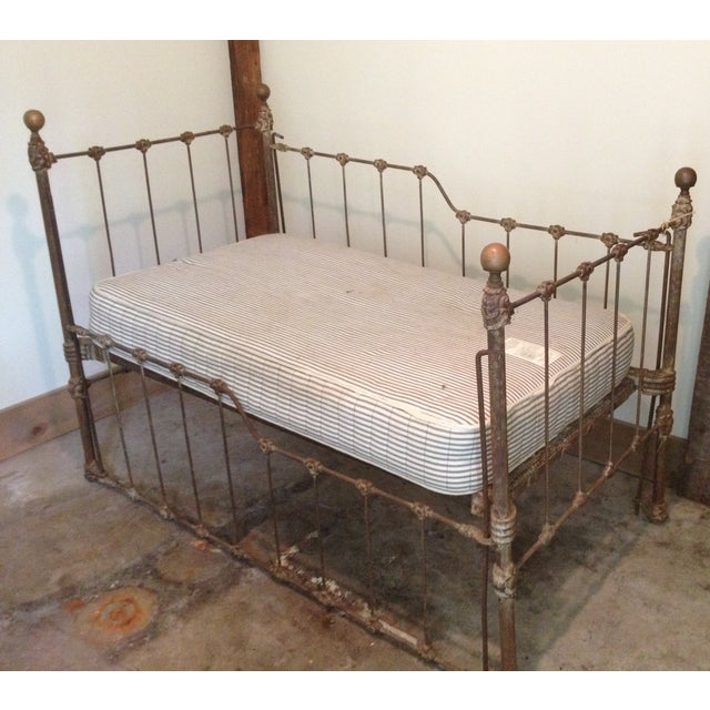 This antique iron child's bed makes a wonderful settee. Fun for child's room or a space-pressed living room. Custom...