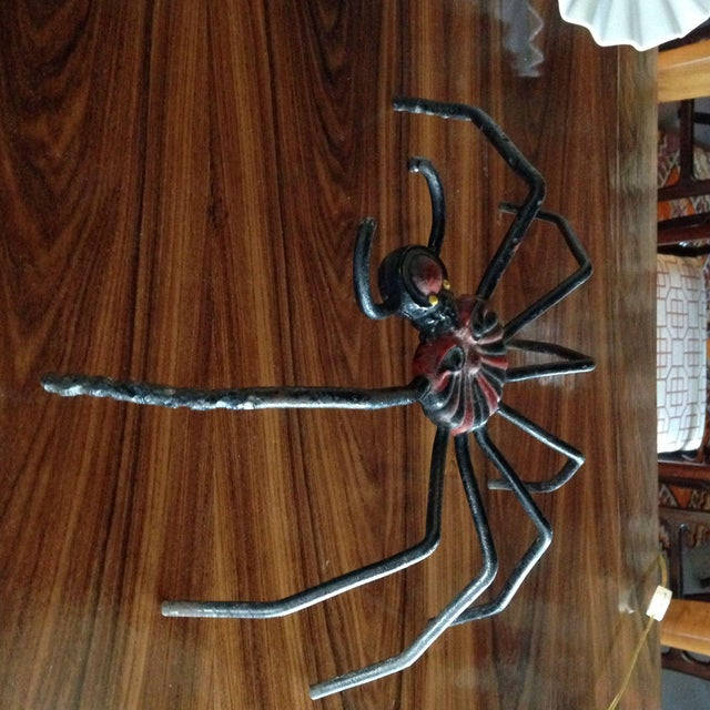 Along came a spider! A wonderfully folky cast iron and metal spider. A great decorative accessory!