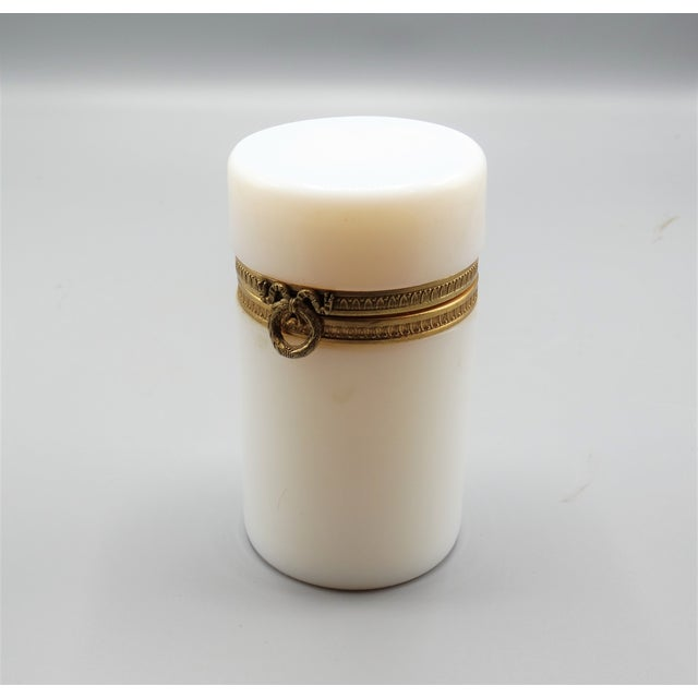 A fine quality antique French bulle de savon opaline hinged box with a lovely wreath ribbon gilt mount. This pretty glass...