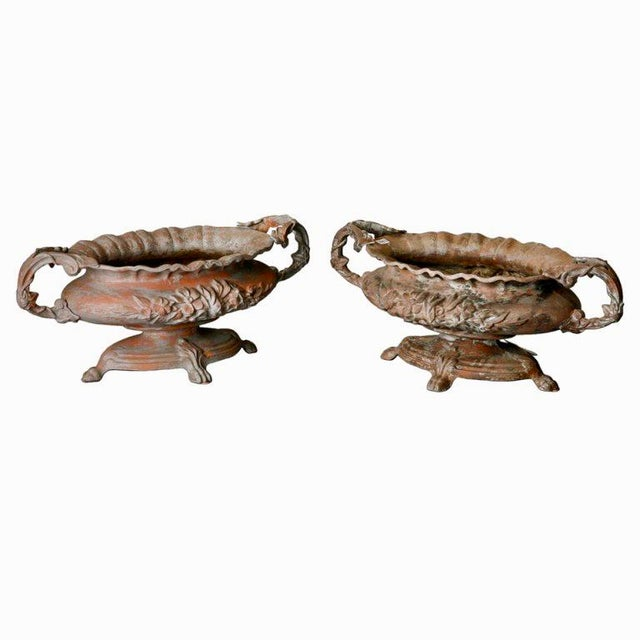 This pair of turn of the century French Chateau footed spelter jardiners have substantial weight, two ornamental handles,...