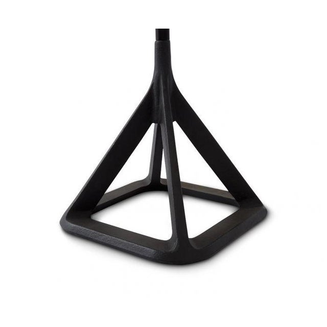 The Base collection combines a smooth finished shade with a matt‑textured cast iron base.