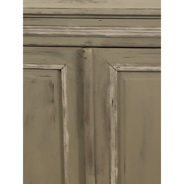 Sturdy naively painted sideboard has old hardware and plenty of storage. This could also be stripped to reveal the...