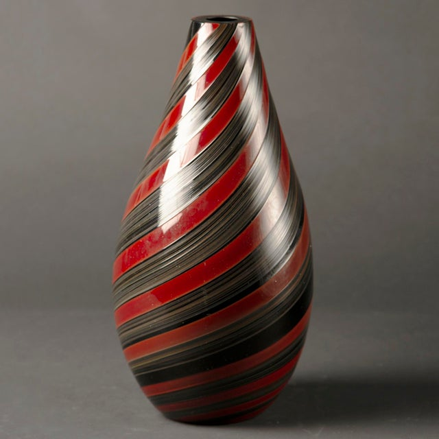 Signed Seguso Murano on the underside of base, this circa 1980s tall, heavy glass vase has stripes of black and red.