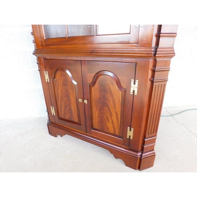 Features Fine Quality Constructed, Chippendale Style, Carved Reeded Corner Columns, Figured Mahogany Raised Panel Doors, 3...