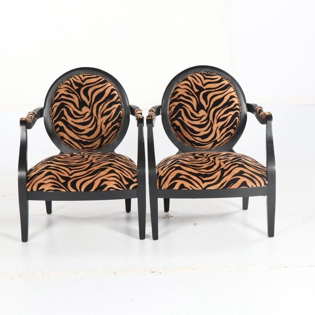 Louis XVI style oval back fauteuil armchairs, upholstered in a lovely animal print chenille with a painted black frame...