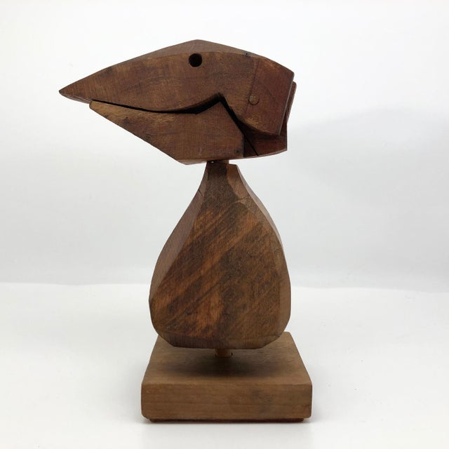 I believe this unusual wooden bird sculpture is one of a kind; I have been unable to find anything like it. I think it is...