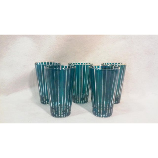"""Cool green striped ice bucket and five tapered tumblers. Bucket 5"""" d x 5.5""""h; tumblers 3""""d at top x 2""""d at bottom x 5""""h...."""