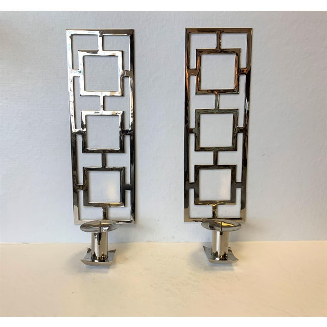 A pair of modern chrome rectangular reticulated wall candle sconces. Excellent condition.