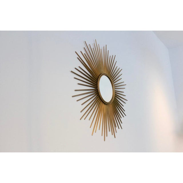 Elegant and beautiful gilded metal framed Sunburst Mirror made in the '60s in France by Chaty Vallauris. Very elegant and...