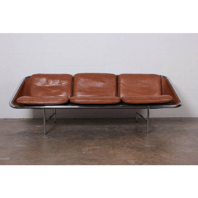 A matching pair of leather sling sofas designed by George Nelson for Herman Miller.