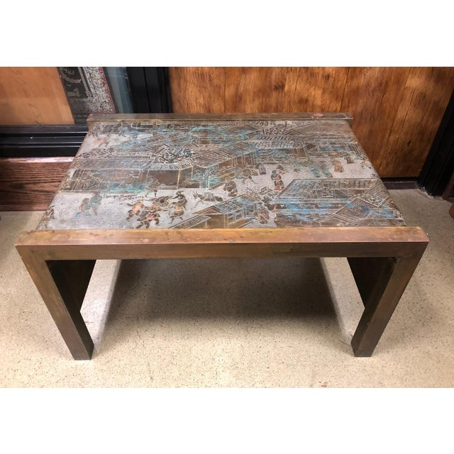 1960s, Philip and Kelvin LaVerne etched bronze waterfall side table from the spring festival collection. Etched patinated...