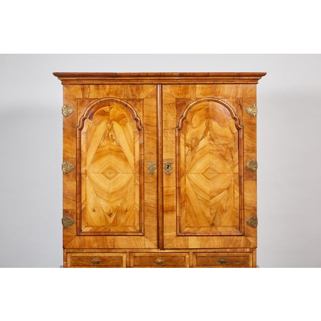 18th century walnut marquetry secretaire with brass hardware and overlaid hinges. The upper cabinet with two doors that...