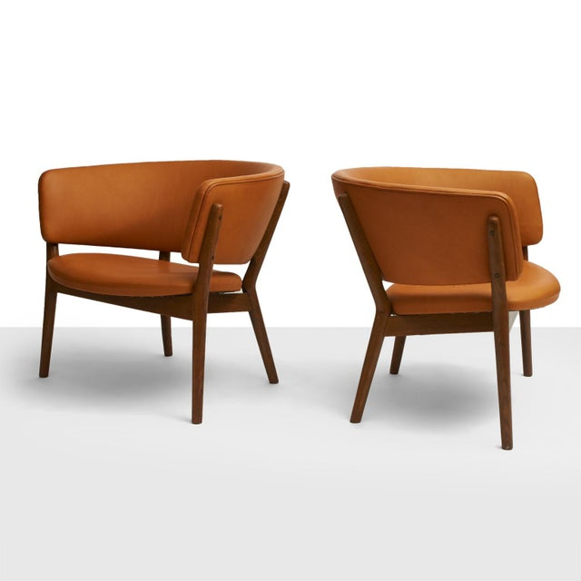Nanna Ditzel Lounge Chairs Model #ND83 A pair of model ND83 lounge chairs. Oak frame and reupholstered in a soft, cognac...