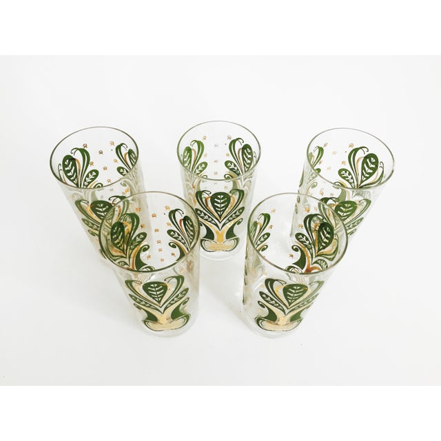 A gorgeous set of 5 tall Mid Century tumblers. Each glass has a bold botanical pattern in green and gold.