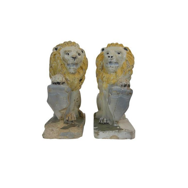 "Pair of painted concrete garden lion statues with shields, in ""Sejant-Rampant"" pose."