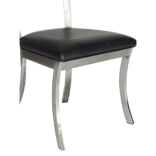 """Set of 4 steel and faux black leather """"Klismos Style"""" chairs. Good Vintage condition."""