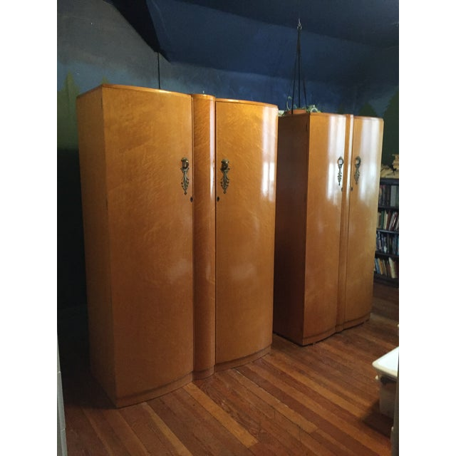 This is a set of two blonde birdseye maple finish wardrobes made by Wrighton Distinctive Furniture, probably made in the...
