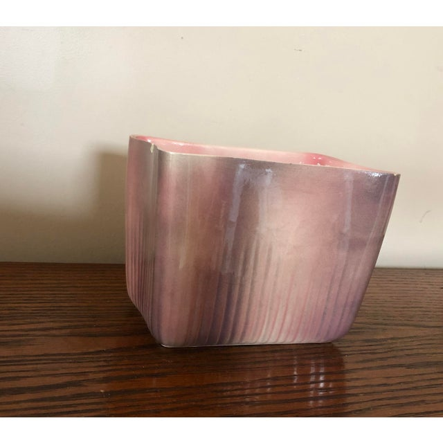 It's a fifties thing. Pink glaze on the inside. If pink is your thing, you will love this piece.