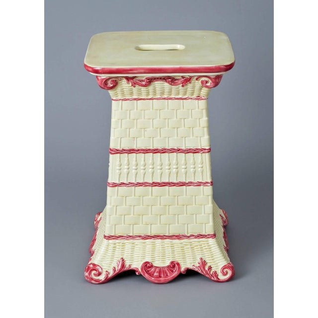 Antique Wedgwood garden seat decorated with four different basket weave designs each separated by dark pink chains, the...