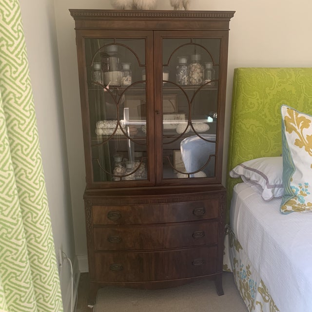 Antique Mahogany China Display Cabinet. Traditional design, beautiful carved details and glass doors with circular wood...