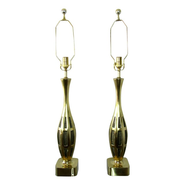 Pair of midcentury lamps designed by Tony Paul for Westwood Lighting in solid brass. Rewired for use in the USA.