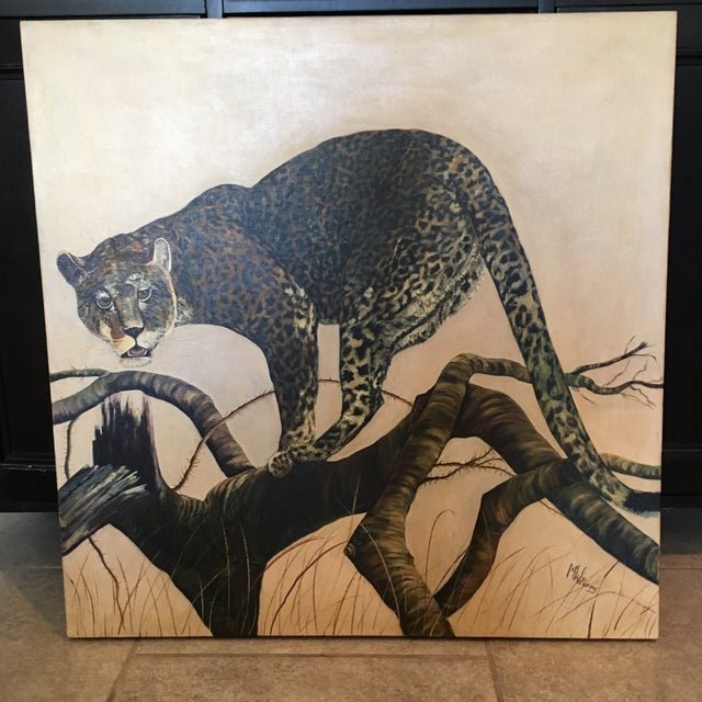 This vintage oil painting was covered in dust when I found it at a high end estate sale. I believe it's a snow leopard but...
