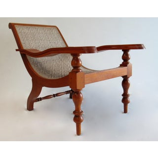Vintage Mid Century British Colonial Teak and Cane Planters Chair With Pivot Arms Preview