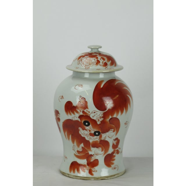 Handmade and painted red dancing lion jar. Antiquing process applied gives this lovely ginger jar a true antique look....