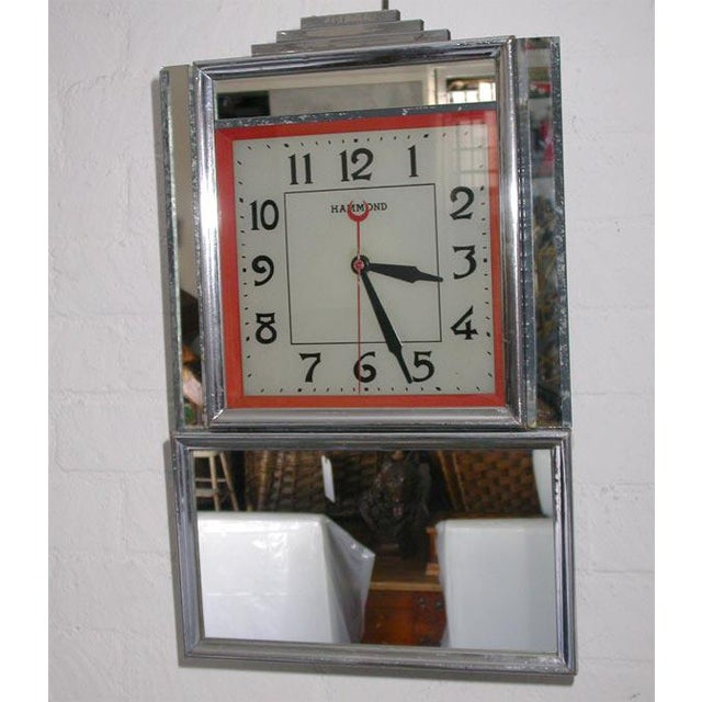 """This electric wall clock has a sweep second hand and the word """"Hammond"""" on the dial which is lighted from a bulb inside..."""