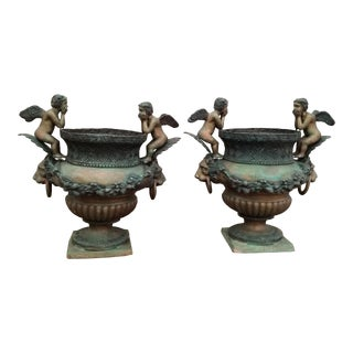 Pair of Bronzed Cherub Urns For Sale